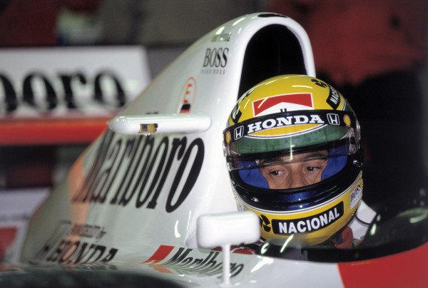 1992 Spanish Grand PrixBarcelona, Spain. 1st - 3rd May.Ayrton Senna (McLaren Honda MP4/7A) checks his mirrors in the garage. He retired from the race. Portrait.World Copyright: LAT Photographicref: 92_ESP_SENNA_A01