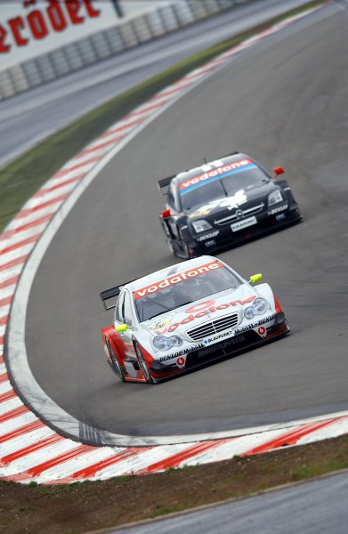 2005 DTM Championship Nurburgring, Germany. 6th - 7th August 2005Bernd Schneider (AMG-Mercedes C-Klasse) leads Laurent Aiello (Opel Vectra GTS V8). Action. World Copyright: Andre Irlmeier / LAT Photographic ref: Digital Image Only