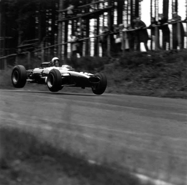 1965 German Grand Prix.Nurburgring, Germany. 1 August 1965.Bruce McLaren, Cooper T77-Climax, retired, action, jump.World Copyright: LAT PhotographicRef: 30343