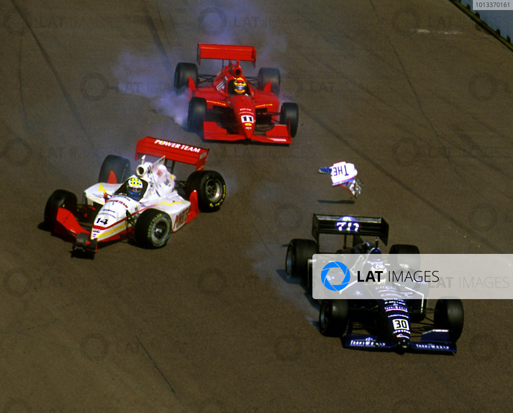 Frame #2: Raul Boesel (#30) and Billy Boat (#11) lock-up their brakes to avoid a spinning Kenny Brack after his contact with Steve Knapp.©F Peirce Williams 1999LAT Photographic