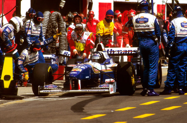 Imola, Italy.3-5 May 1996.Damon Hill (Williams FW18 Renault) 1st position, takes a pitstop.Ref-96 SM 12.World Copyright - LAT Photographic