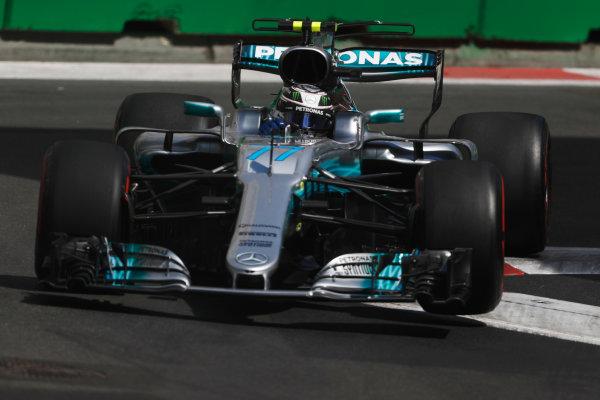 Baku City Circuit, Baku, Azerbaijan. Friday 23 June 2017. Valtteri Bottas, Mercedes F1 W08 EQ Power+, lifts a wheel bouncing over a kerb. World Copyright: Glenn Dunbar/LAT Images ref: Digital Image _X4I0324