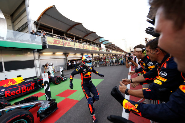 Baku City Circuit, Baku, Azerbaijan. Sunday 25 June 2017. Daniel Ricciardo, Red Bull Racing, celebrates his victory with colleagues in parc ferme. World Copyright: Glenn Dunbar/LAT Images ref: Digital Image _31I3730