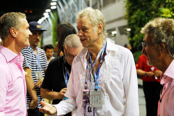 Marina Bay Circuit, Singapore. Saturday 21st September 2013.  Bob Geldof talks to David Coulthard in the paddock.  World Copyright: Jed Leicester/LAT Photographic. ref: Digital Image _JED2615