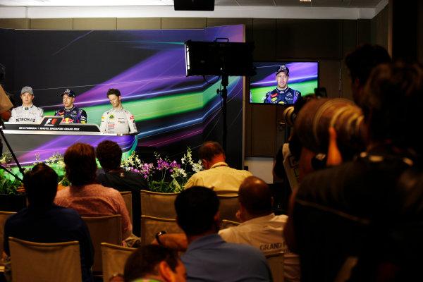 Marina Bay Circuit, Singapore. Saturday 21st September 2013.  Nico Rosberg, Mercedes AMG, Sebastian Vettel, Red Bull Racing, and Romain Grosjean, Lotus F1, in the press conference after qualifying.  World Copyright: Charles Coates/LAT Photographic. ref: Digital Image _N7T5288