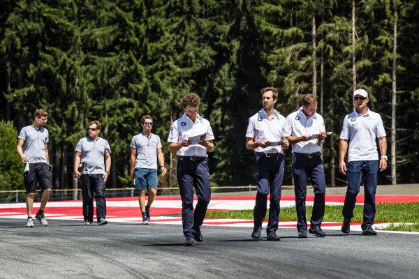 Joey Hand, BMW Team RBM BMW M4 DTM walks the track with his team