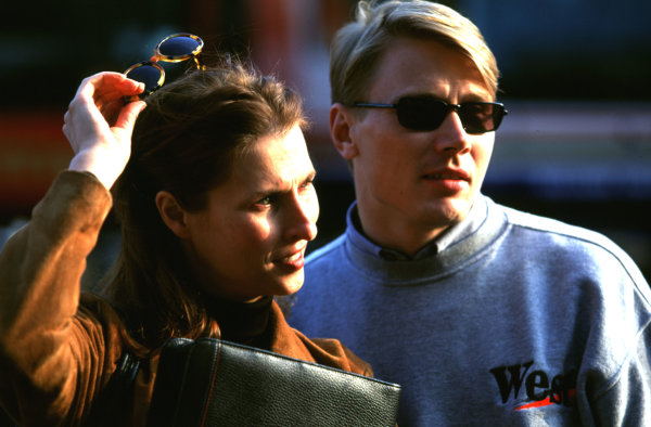 1998 San Marino Grand Prix.Imola, Italy.24-26 April 1998.Mika Hakkinen with his wife Erja.World Copyright - LAT Photographic
