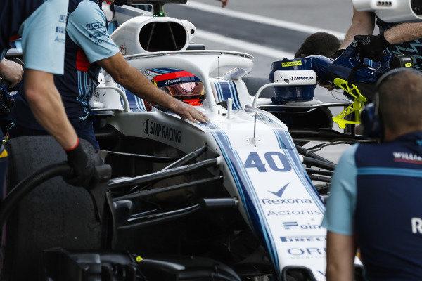 Robert Kubica, Williams FW41 Mercedes, stops in his pit area.