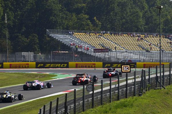 Valtteri Bottas, Mercedes F1 W11 EQ Performance, leads Lewis Hamilton, Mercedes F1 W11 EQ Performance, Charles Leclerc, Ferrari SF1000, Alexander Albon, Red Bull Racing RB16, and the rest of the field