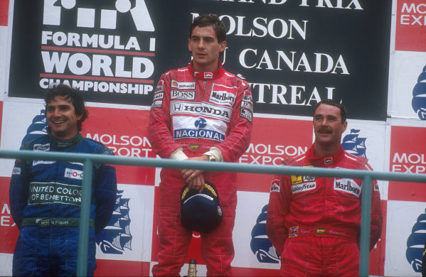 1990 Canadian Grand Prix.Montreal, Canada.8-10 June 1990.Ayrton Senna (McLaren Honda) 1st position, Nelson Piquet (Benetton Ford) 2nd position and Nigel Mansell (Ferrari) 3rd position on the podium.Ref-90 CAN 10.World Copyright - LAT Photographic