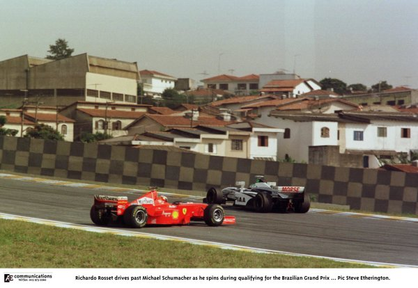 1998 Brazilian Grand Prix.Interlagos, Sao Paulo, Brazil.27-29 March 1998.Ricardo Rosset (Tyrrell 026 Ford) drives past Michael Schumacher (Ferrari F300) as he spins during qualifying.World Copyright - Steve Etherington/LAT Photographic