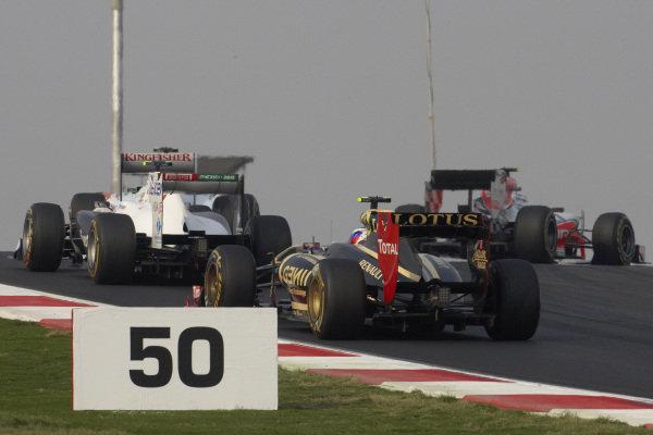 Vitaly Petrov, Renault R31, follows Sergio Pérez, Sauber C30 Ferrari, Paul di Resta, Force India VJM04 Mercedes, and Daniel Ricciardo, HRT F111 Cosworth.