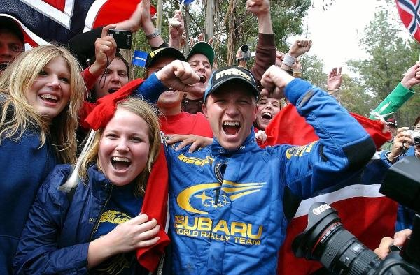 Rally winner Petter Solberg (NOR) Subaru celebrates victory with Norwegian fans at the end of the final stage.