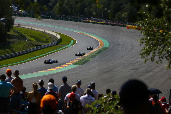 Kevin Magnussen, Haas VF-19, leads Valtteri Bottas, Mercedes AMG W10, and Lewis Hamilton, Mercedes AMG F1 W10