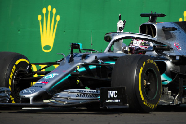 Lewis Hamilton, Mercedes AMG F1 W10, 1st position, celebrates after taking the Chequered flag