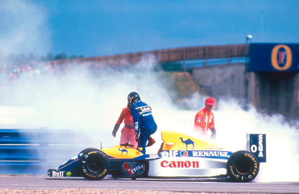 1993 British Grand Prix.Silverstone, England.9-11 July 1993.Damon Hill (Williams FW15C Renault) retires from the race as his engine expires, with marshals putting out the flames.Ref-93 GB 14.World Copyright - LAT Photographic