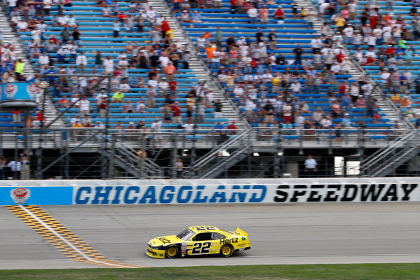 20-21 July, 2013, Joliet, Illinois USA Joey Logano takes the checkered flag to win the race ©2013, Lesley Ann Miller LAT Photo USA