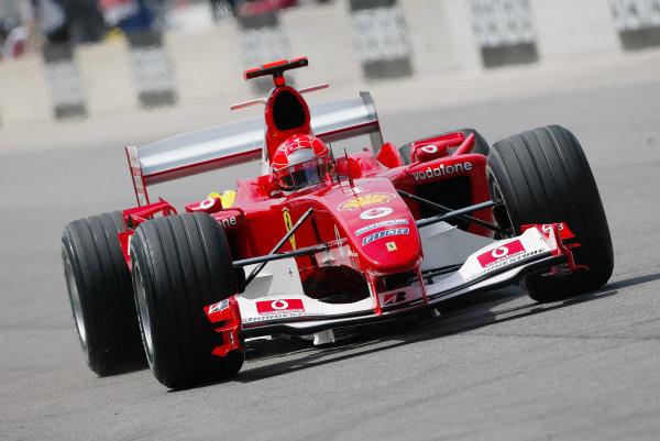 2004 United States Grand Prix - Friday Practice,Indianapolis, USA. 18th June 2004 Michael Schumacher, Ferrari F2004, action.World Copyright: Steve Etherington/LAT Photographic ref: Digital Image Only