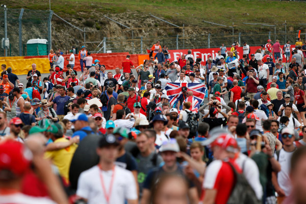Spa-Francorchamps, Spa, Belgium. Sunday 23 August 2015. Fans invade the circuit after the race. World Copyright: Zak Mauger/LAT Photographic. ref: Digital Image _L0U5488
