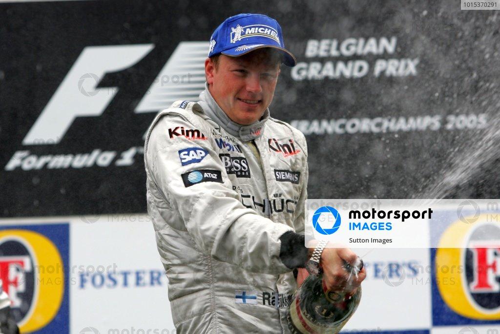 Race winner Kimi Raikkonen (FIN) McLaren sprays the champagne on the podium.  Formula One World Championship, Rd16, Belgian Grand Prix, Race, Spa Francorchamps, Belgium,  11 September 2005. DIGITAL IMAGE