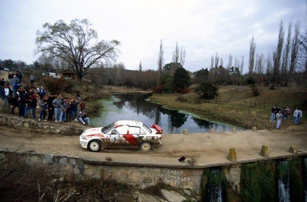 1996 World Rally Championship.Argentine Rally, Argentina. 4-6 July 1996.Tommi Makinen/Seppo Harjanne (Mitsubishi Lancer Evo3), 1st position.World Copyright: LAT PhotographicRef: 35mm transparency 96RALLY05