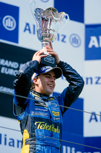 2005 European Grand Prix Nurburgring, Germany. 27th - 29th May. Fernando Alonso, Renault R25 celebrates on the podium with his trophy World Copyright: LAT Photographic ref: 35mm Image: 05Monaco06