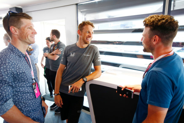 Monte Carlo, Monaco. Saturday 27 May 2017. Jenson Button, McLaren MCL32 Honda, poses for a picture with cyclists Mark Renshaw Mark Cavendish. World Copyright: Andy Hone/LAT Images ref: Digital Image _ONY0206