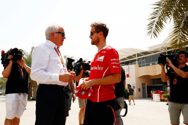 Bahrain International Circuit, Sakhir, Bahrain.  Thursday 13 April 2017. Sebastian Vettel, Ferrari, talks with Charlie Whiting, Race Director, FIA, in the paddock. World Copyright: Sam Bloxham/LAT Images ref: Digital Image _J6I8343