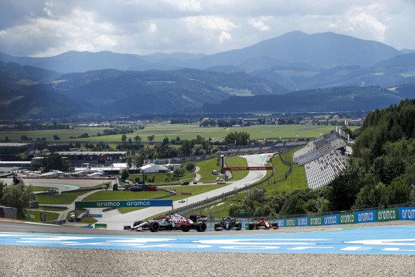 Robert Kubica, Alfa Romeo Racing C41, leads Valtteri Bottas, Mercedes W12, and Carlos Sainz, Ferrari SF21