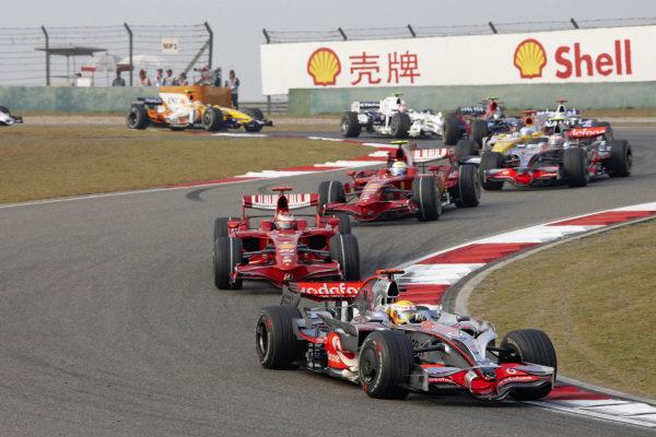 Lewis Hamilton, McLaren MP4-23 Mercedes leads Kimi Räikkönen, Ferrari F2008 and Felipe Massa, Ferrari F2008.