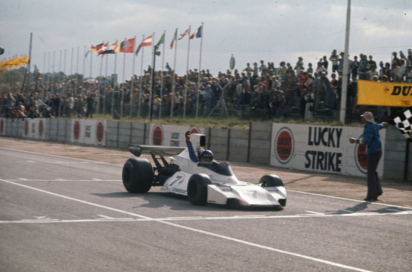 Carlos Reutemann, Brabham BT44 Ford takes the chequered flag for victory.