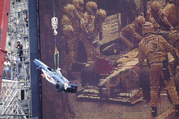 2003 Racing Past. . Exhibition1998 Monaco Grand Prix, Monte Carlo. A crane winches away the wrecked Benetton of Alex Wurz.World Copyright - LAT PhotographicExhibition ref: a020
