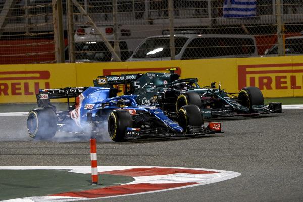 Fernando Alonso, Alpine A521, leads Sebastian Vettel, Aston Martin AMR21