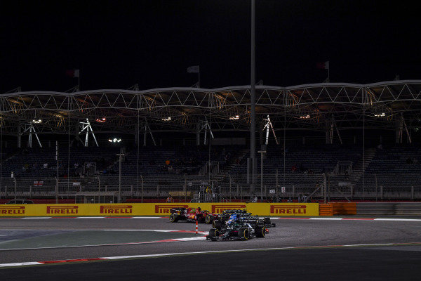 Lance Stroll, Aston Martin AMR21, leads Fernando Alonso, Alpine A521, Sebastian Vettel, Aston Martin AMR21, and Carlos Sainz, Ferrari SF21