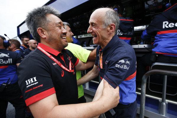 Masashi Yamamoto, General Manager, Honda Motorsport, and Franz Tost, Team Principal, Toro Rosso, celebrate a podium