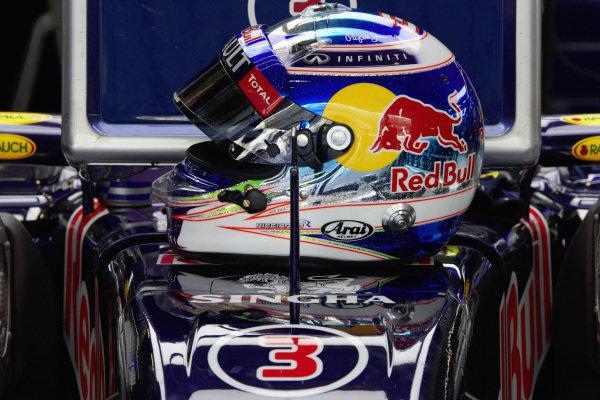 Daniel Ricciardo, Red Bull RB11 Renault helmet onto of car.