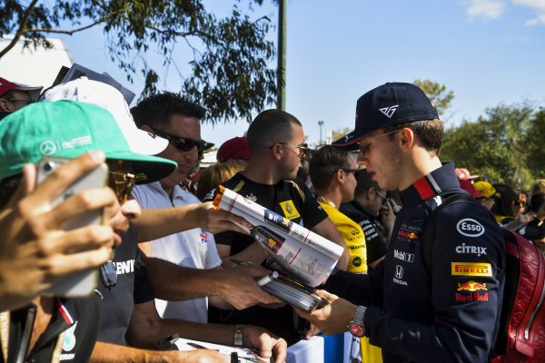 Pierre Gasly, Red Bull Racing signs a autograph for a fan