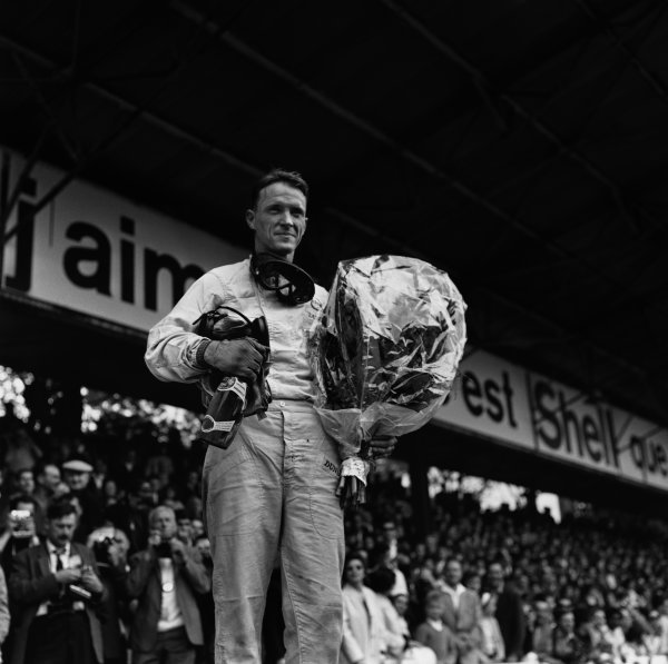Rouen, France. 25th June 1964.Dan Gurney (Brabham BT7-Climax) 1st position, podium, portrait.World Copyright: LAT Photographic.Ref: 19840.