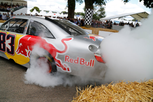 2014 Goodwood Festival of Speed  Goodwood Estate, West Sussex, England. 26th - 29th June 2014.  Sunday 29 June 2014. Patrick Friesacher, Red Bull Toyota Camry NASCAR. World Copyright: Adam Warner/LAT Photographic. ref: Digital Image _L5R7606