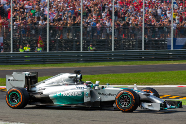 Autodromo Nazionale di Monza, Monza, Italy. Sunday 7 September 2014. Lewis Hamilton, Mercedes F1 W05 Hybrid, 1st Position, celebrates on his way to Parc Ferme. World Copyright: Sam Bloxham/LAT Photographic. ref: Digital Image _SBL4048