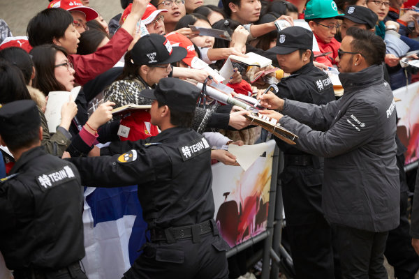 Shanghai International Circuit, Shanghai, China. Thursday 9 April 2015. Lewis Hamilton, Mercedes AMG signs autographs for fans. World Copyright: Steve Etherington/LAT Photographic. ref: Digital Image SNE26880
