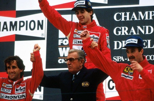 The podium (L to R): Alain Prost (FRA) second; Ayrton Senna (BRA) winner; Nigel Mansell (GBR) third. In the centre is FISA President Jean Marie Balestre letting everyone know who believed the stars of the race to be after their exciting battle.  Belgian Grand Prix, Spa-Francorchamps, 27 Aug 1989.