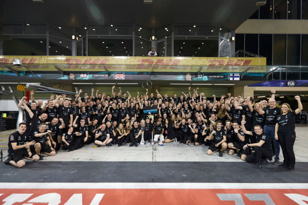 Yas Marina Circuit, Abu Dhabi, United Arab Emirates. Sunday 26 November 2017. Toto Wolff, Executive Director (Business), Mercedes AMG, Valtteri Bottas, Mercedes AMG, 1st Position, his wife Emelia, Lewis Hamilton, Mercedes AMG, 2nd Position, and the Mercedes team celebrate a great race result and another highly successful season. World Copyright: Steve Etherington/LAT Images  ref: Digital Image SNE21332