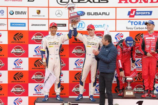 2017 Japanese Super GT Series. Motegi, Japan.  11th - 12th November 2017. Rd 8. GT500 2017 Driver's Champion Ryo Hirakawa & Nick Cassidy ( #37  KeePer TOM'S LC500 ) podium portrait World Copyright: Yasushi Ishihara/LAT Images ref: Digital Image 2017_SGT_Rd8_020