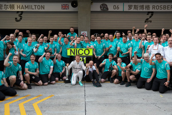 Shanghai International Circuit, Shanghai, China. Sunday 17 April 2016. Nico Rosberg, Mercedes AMG, 1st Position, Tony Ross, Race Engineer, Mercedes AMG, and the Mercedes team celebrate victory after the race. World Copyright: Steve Etherington/LAT Photographic ref: Digital Image SNE12639