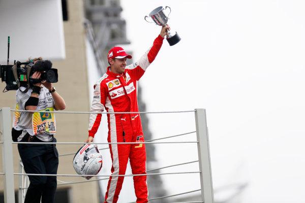 Interlagos, Sao Paulo, Brazil. Sunday 15 November 2015. Sebastian Vettel, Ferrari, 3rd Position, with his trophy on the podium. World Copyright: Alastair Staley/LAT Photographic ref: Digital Image _79P5867
