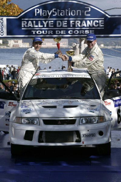 2003 FIA World Rally Champs. Round Twelve Corsica Rally 16th-19th October 2003.Niall McShea & co-driver Chris Patterson celebrate Group n victory.World Copyright: McKlein/LAT