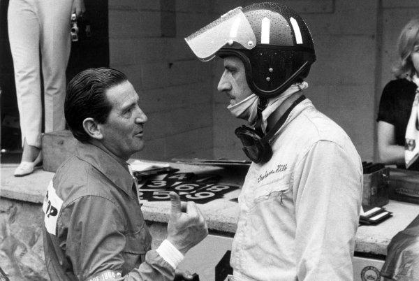 1966 Belgian Grand Prix.Spa-Francorchamps, Belgium. 12 June 1966.Graham Hill, BRM P261, retired, in the pits after retiring, portrait, helmet.World Copyright: LAT PhotographicRef: Motor b&w print