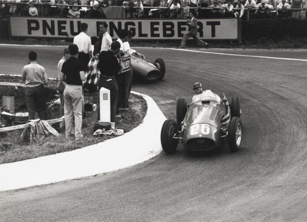 1954 Belgian Grand Prix.Spa-Francorchamps, Belgium. 20 June 1954.Juan Manuel Fangio, Maserati 250F, 1st position, leads Mike Hawthorn, Ferrari 625, 4th position, action.World Copyright: LAT PhotographicRef: 197/7