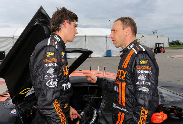 31 May-1 June, 2013, Detroit, Michigan, USA Jordan Taylor, left, talks with co-driver Max Angelelli after winning the pole position. ©2013, R D. Ethan LAT Photo USA
